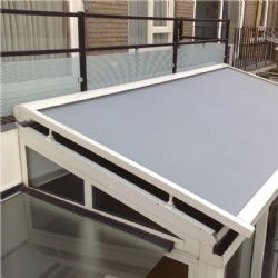 Motorized retractable roof mounted awning
